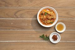 Thai Food Red Curry Pork. Red Curry savory Pork with bamboo slice on wooden barckground,Thai food the original royalty free stock photo