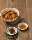 Thai Food Red Curry Pork. Red Curry savory Pork with bamboo slice on wooden barckground,Thai food the original stock photo