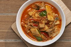 Thai Food Red Curry Pork. Red Curry savory Pork with bamboo slice on wooden barckground,Thai food the original royalty free stock photos