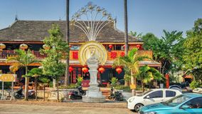 Thai food restaurant with street light in peacock style. Jinghong town, Yunnan province, China-March 15, 2018: Southeast Asian food center of typical 2 floor stock image