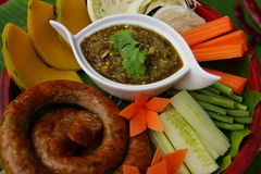 Thai food sausages and chilly paste stock images