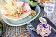 Thai food set menu on outdoor table with sun glare Stock Images