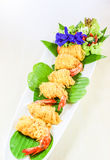 Thai food, Shrimp rhoom or Shrimp La-tiang. Thai food called Shrimp rhoom or Shrimp La-tiang ; (Minced Shrimp wrapped in Egg-net Royalty Free Stock Photo