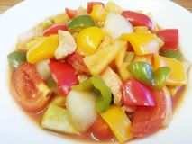 Thai food Sour and Sweet Stir-Fry. Thai food : Sweet and sour sauce fried with pork,tomato ,pineapple, sweet chill, tomato, cucumber ,onion royalty free stock photos