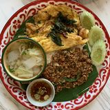 Thai Spicy basil beef with fried egg and soup royalty free stock photos