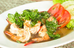 Thai food, Spicy fried shrimp with basil Stock Photo
