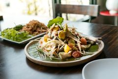 Thai food spicy green papaya salad, applied gain noise filter Stock Photos