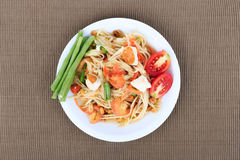 Thai food, Spicy green papaya salad with salted egg (Som Tum Thai Kai Kem) on Brown Cloth Background. Original spicy Thai food is the most popular Royalty Free Stock Photos