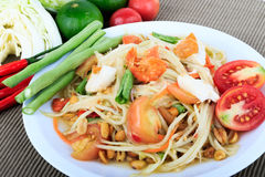 Thai food, Spicy green papaya salad with salted egg (Som Tum Thai Kai Kem) on Brown Cloth Background. Original spicy Thai food is the most popular Stock Photos