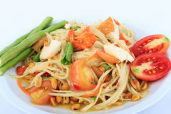 Thai food, Spicy green papaya salad with salted egg (Som Tum Thai Kai Kem) on White Background. Original spicy Thai food is the most popular Stock Photography