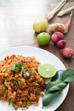 Thai food, Spicy healthy fried rice with herbs. Thai food, Spicy healthy fried rice on white dish with herbs on wood table with copy space stock photography