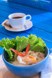 Thai food,Spicy lemongrass flavored flat noodles with seafood. Spicy TOM YAM  Seafood noodle soup with lemongrass, chilly pasted and lime juice Stock Photo
