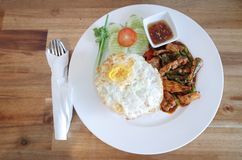 Thai food. Spicy pork with rice and fried egg Stock Photos