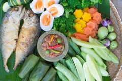 Thai food, spicy shrimp paste chilli sauce in mortar stone. With fried mackerel and boil egg and vegetable Stock Photos