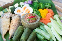 Thai food, spicy shrimp paste chilli sauce in mortar stone. With fried mackerel and boil egg and vegetable Royalty Free Stock Photos