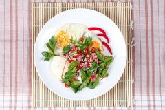 Thai food,Spicy wing bean with pork topped fried egg. Stock Photography