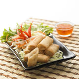 Thai Food Spring Rolls. Spring Rolls in the black plate Stock Photo