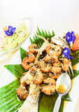 Thai food, steamed snapper fish and shrimp. Decoration by flowers, papaya and banana leaf. it is general menu for Asia Stock Images