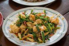 Thai food, Stir-fried squid with salted duck eggs. stock photos