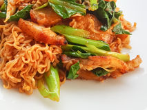 Thai food stlye:Spicy Stir fried instant noodle &fried pork curr Royalty Free Stock Photos