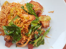 Thai food stlye:Spicy Stir fried instant noodle &fried pork stock images