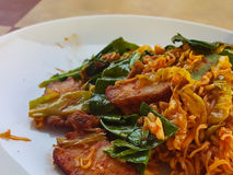 Thai food stlye:Spicy Stir fried instant noodle &fried pork Royalty Free Stock Photo