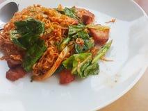 Thai food stlye:Spicy Stir fried instant noodle &fried pork stock photos