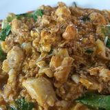 Thai food. Stri fried crab meat in yellow curry Royalty Free Stock Image