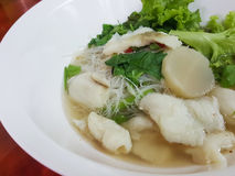 Thai food style:A fish noodle soup served with meatballs. Stock Photos