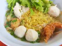 Thai food style:A prawn noodle soup served with pork and meaball. Stock Photo