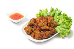 Thai Food Thai Fried Fish Cake Called Tod Mun Pla. Thai fried fish cake (Tod Mun Pla) or prawn fritter ball serve with red sauce Thai traditional food recipe Royalty Free Stock Images