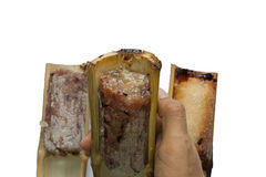 Thai foods Glutinous rice roasted in bamboo on white background Stock Photo