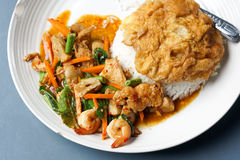 Thai foods for lunch time. The spicy basil with rice and fried egg for lunch time in Thailand Stock Images