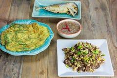 Thai foods, mushrooms fried egg, Fried Tuna , Shrimp paste chili sauce, Omelet Stock Photos