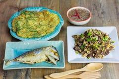 Thai foods, mushrooms fried egg, Fried Tuna , Shrimp paste chili sauce, Omelet Royalty Free Stock Images