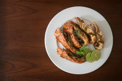 Thai Foods : stir-fried rock lobster with chilli, garlic and Tha. I herbs roasted on frying pan on dark background Kang Pad Kratiem Prik sod Stock Photo