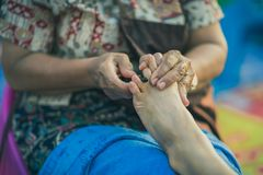 Thai foot massage on street for resting place on annual festival.  stock image