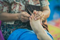 Thai foot massage on street for resting place on annual festival.  royalty free stock photos