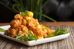 Thai Fried Calamari. Appetizer with fresh pineapple chunks Stock Photography
