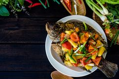 Thai Fried Fish and Topped with Fried Stir Sweet and Sour royalty free stock image