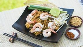 Thai Fried Noodle With Prawn Pad Thai Gung Sod. Thai food Pad thai is fried with shrimp Thailand style original banana leaf bottom groove Stock Photos