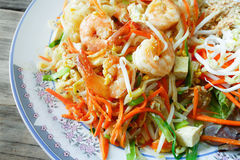 Thai Fried Noodles / Delicious rice noodles with shrimp close-up on a shrimp/Thai food Pad thai Royalty Free Stock Images