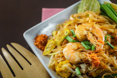 Thai Fried Noodles with fresh shrimp in closeup Stock Photos