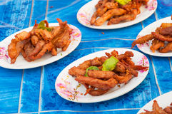 Thai fried pork jerky on plate on table sale at stall Stock Photo