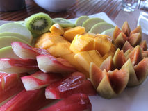 Thai Fruit Patter, Breakfast. An appetizing breakfast of tropical Fruits, artistically decorated to start the day on a health note. Nowhere than in Thailand do Stock Photo
