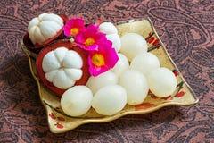 Thai fruit. Thai rambutan and mangosteen fruit served on ceramic dish decoration with little common purslane flowers Royalty Free Stock Photos