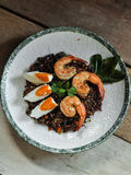Thai fusion food, Dry Tomyum riceberry with shrimp and salted egg stock photography