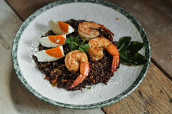 Thai fusion food, Dry Tomyum riceberry with shrimp and salted egg stock images
