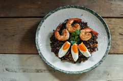 Thai fusion food, Dry Tomyum riceberry with shrimp and salted egg stock image