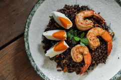 Thai fusion food, Dry Tomyum riceberry with shrimp and salted eg Royalty Free Stock Photo